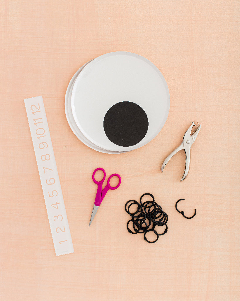 """materials: plates, 1"""" binder rings, hole punch, scissors, ruler"""
