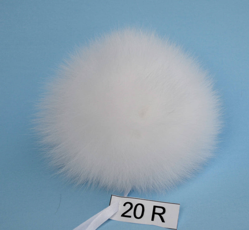 white fur pom pom ball