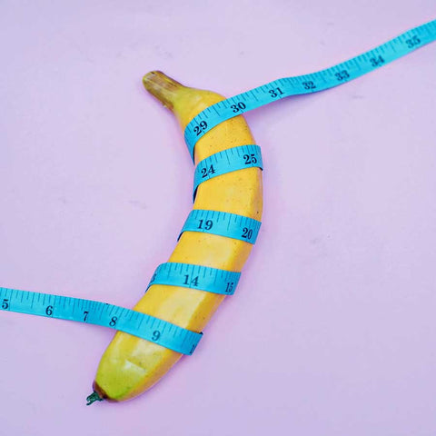 banana wrapped in a tape measure