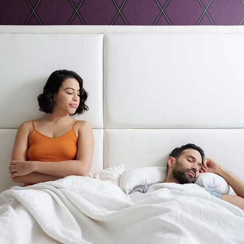 man and woman on bed