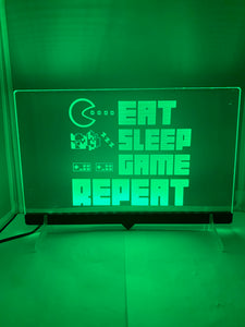 "Enseigne DEL ""Eat Sleep Game Repeat"" avec support"