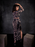 Micheline Pitt with her body turned away from the camera while wearing the Alien™ Xenomorph Skirt and Top Set.