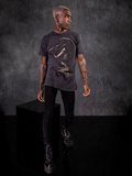 Male model wearing black vinyl combat boots and the Alien™ Xenomorph in Repose Vintage Short Sleeve in Grey.