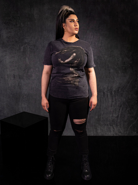 Jyoti Kaur standing up and looking off and up to the left while wearing the Alien™ Xenomorph in Repose Vintage Short Sleeve in Grey.