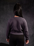 Back of the Alien™ Xenomorph Profile Vintage-Style Cropped Sweatshirt photographed on female model.