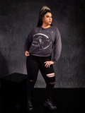 Jyoti Kaur wearing the Alien™ Xenomorph Profile Vintage-Style Cropped Sweatshirt from goth inspired clothing bran La Femme en Noir.