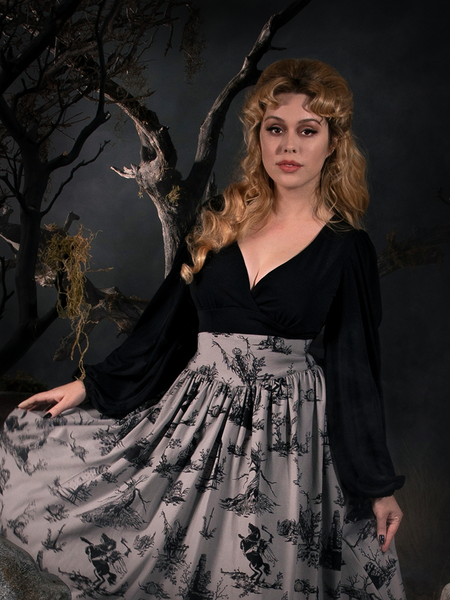 Linda in a gothic style outfit including the Bishop Blouse in Black and grey Sleepy Hollow skirt.