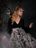 Bishop Blouse in Black worn by Linda in a spooky graveyard.