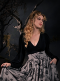 Linda in the Bishop Blouse in Black photographed in a grey Sleepy Hollow skirt.