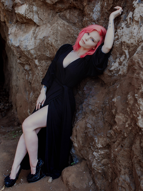 Model Mackenzie showing off the Black Widow Wrap Gown in Solid Black from La Femme en Noir.