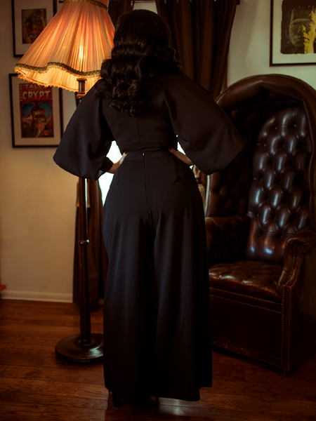 Rachel Sedory showing off the backside of the Black Widow Palazzo Pants in Black from gothic vintage clothing retailer and maker La Femme en Noir.