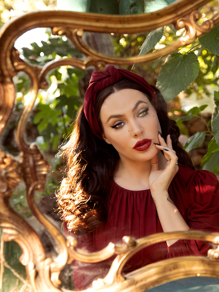 Micheline Pitt showing off her gothic vintage outfit with Art Deco Head Scarf in Crimson Ponte and blood red flowy top.