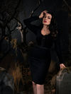 Micheline wearing the Sleepy Hollow Gothic Tales Velour Wiggle Dress in Black from La Femme en Noir.