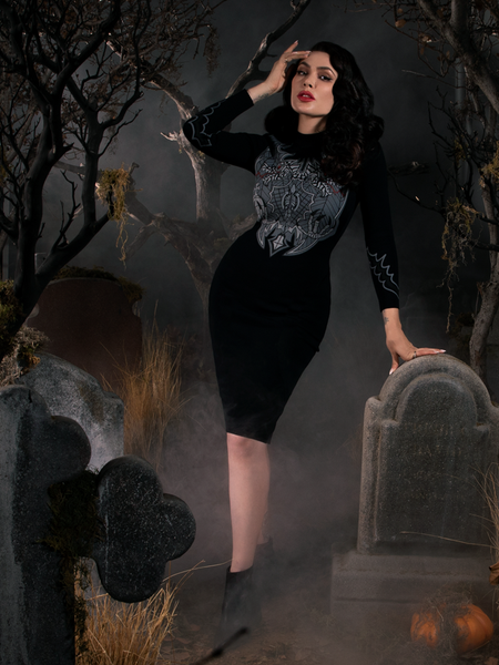 Micheline Pitt wearing a black gothic dress from Sleepy Hollow named Sleepy Hollow Hessian Dress in Black.