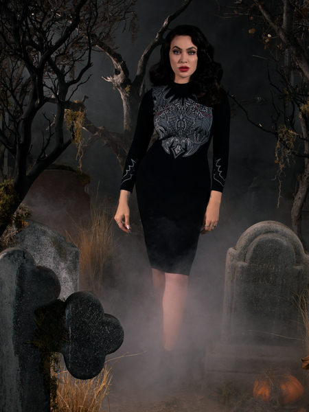 Full length shot of Micheline Pitt wearing a black gothic dress inspired by the Sleepy Hollow movie.