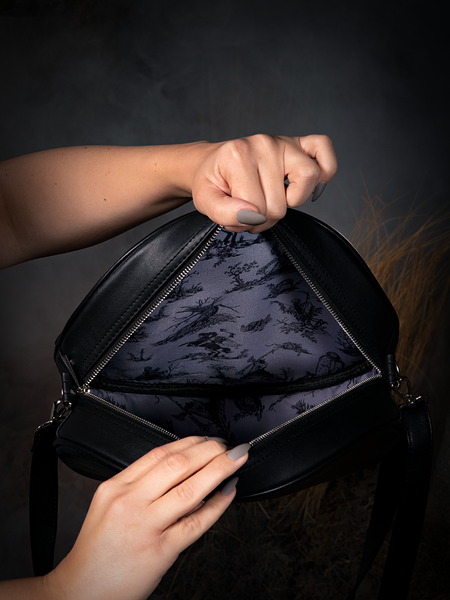 Photo of the lining of the Sleepy Hollow Headless Horseman Crossbody Bag in Black and Red.