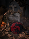 Shot of Sleepy Hollow Headless Horseman Crossbody Bag in Black and Red posed against a tombstone amongst a foggy, leave-riddled area.
