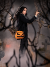Micheline Pitt, dressed as Ichabod Crane, is turned to the side to show off the Sleepy Hollow Pumpkin Bag.