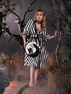 Linda standing in a foggy cemetery while modeling a gothic retro dress paired with the Sleepy Hollow purse.