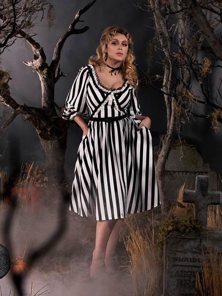 Linda tucking her hands into the pockets of her Sleepy Hollow Katrina Dress in Black and White Dress.