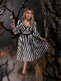Full length gothic dress worn by Linda standing in a gothic graveyard.