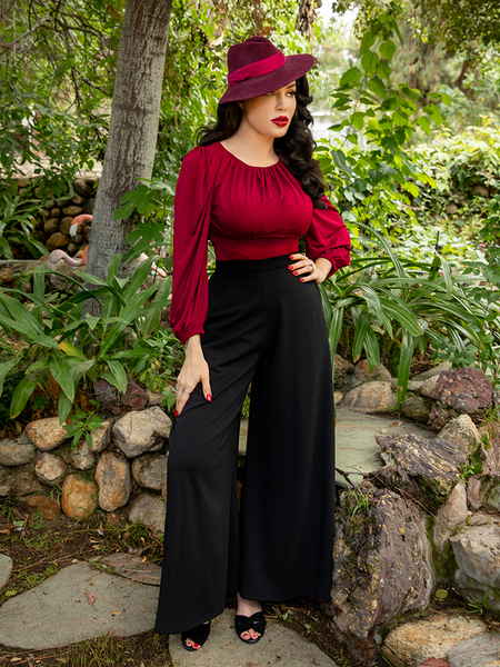 Micheline Pitt posed in her goth inspired outfit featuring the Opera Satin Palazzo Pants.