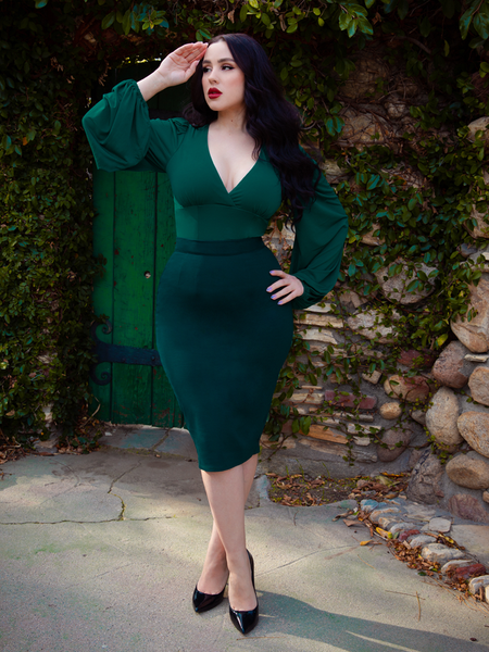 Full length shot of Rachel Sedory wearing the New Bishop Blouse in Hunter Green from La Femme en Noir.