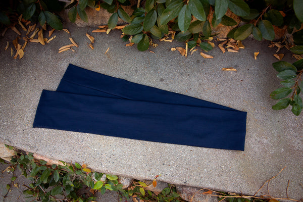 Product shot of the Art Deco Head Scarf in Navy Ponte.