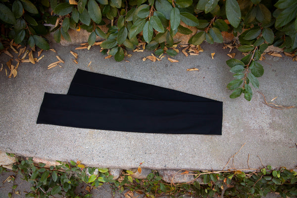 Isolated product shot of the Art Deco Head Scarf in Black Ponte.