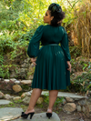 Ashleeta showing off the backside of her hunter green Salem Dress from La Femme en Noir.