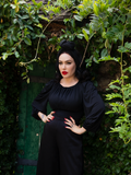 With her hands on her hips, Micheline shows off her gothic retro clothing outfit including the Salem Top in Black.