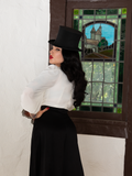 Micheline Pitt showing off the back of the Salem Top in Ivory.