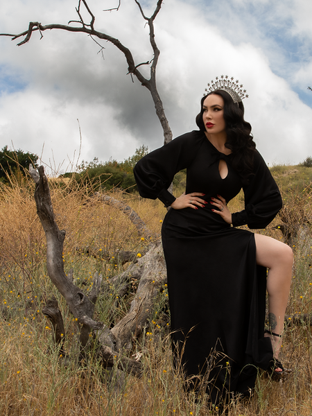 Micheline Pitt shows off the Opera Satin Gown in Black - a goth inspired glamourous gown from La Femme en Noir.