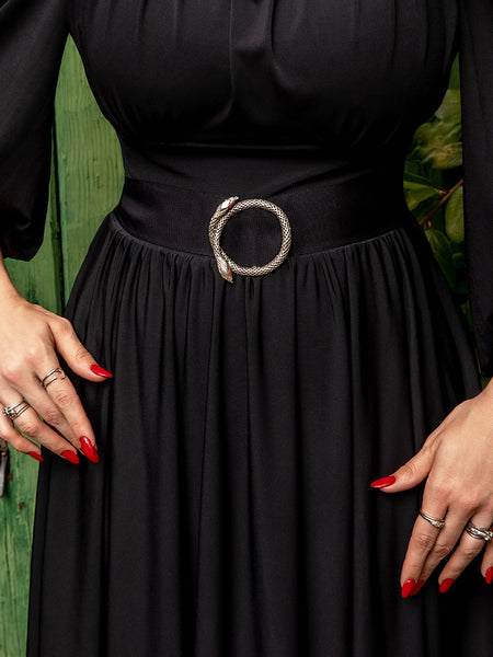 Close-up image of the Serpentine Infinity Buckle in Antique Silver being worn with a black gown.