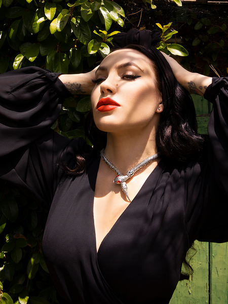 Micheline Pitt modeling the Serpentine Choker in Antique Silver along with a black long sleeve flowy top from La Femme en Noir.