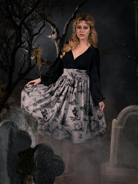 Linda pulling out the sides of her Sleepy Hollow Gothic Tales Toile Skirt in Grey to show off her gothic retro outfit.