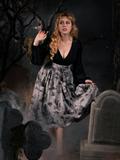 Linda in the Sleepy Hollow Gothic Tales Toile Skirt in Grey.