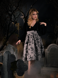 Linda posing while in the Sleepy Hollow Gothic Tales Toile Skirt in Grey.