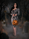 Rachel models the Sleepy Hollow Pumpkin Bag while wearing a grey Sleepy Hollow inspired dress.