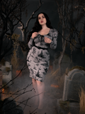 Full body length shot of Rachel in the Sleepy Hollow Gothic Tales Toile Wiggle Dress in Grey from La Femme en Noir.