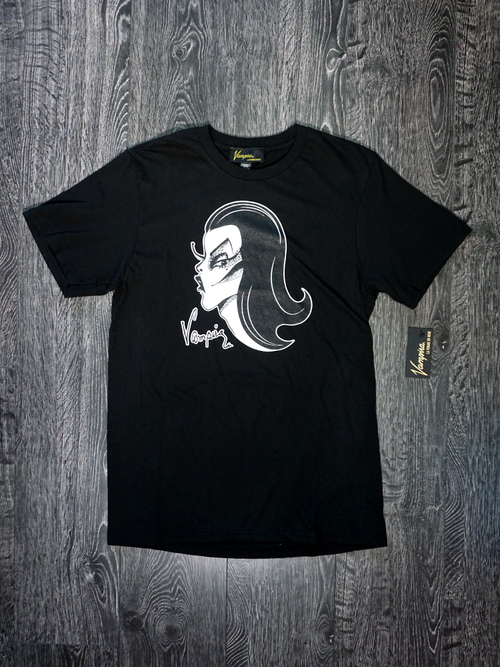 A product photo of the men's Vampira black tee on a wooden background.