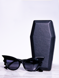 Isolated product shot of the Vamp Batwing Sunglasses in Black from gothic vintage clothing company La Femme en Noir.