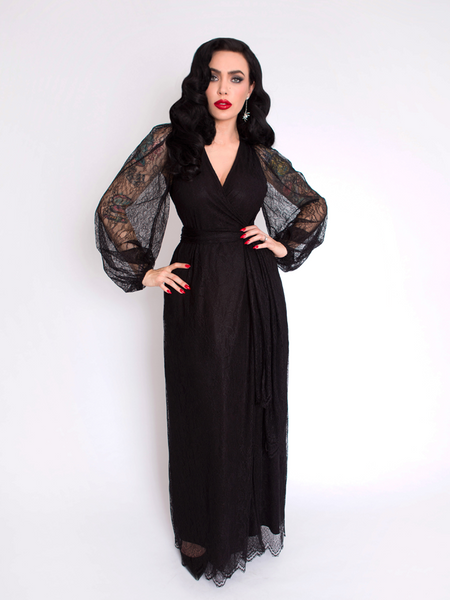 Micheline Pitt modeling the Black Widow Wrap Gown in Black Lace from gothic retro clothing company La Femme en Noir.