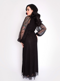 Micheline Pitt showing off the backside of the Black Widow Wrap Gown in Black Lace from La Femme en Noir.