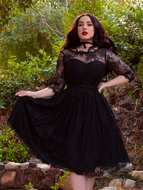 Mourning Dress in Black Lace worn by model Rachel Sedory in a secluded and enchanted looking forest.