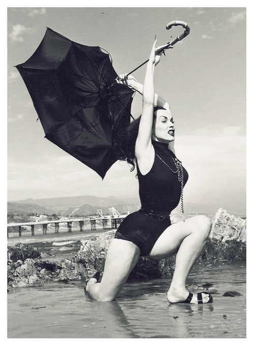 Vintage picture of Vampira wearing a Glamour Ghoul style Swimsuit.