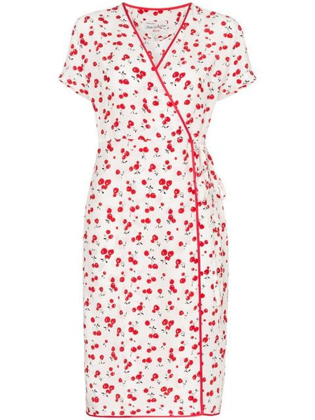 The HVN Vera Wrap Dress flaunts a kitschy cherry print and contrast piping.