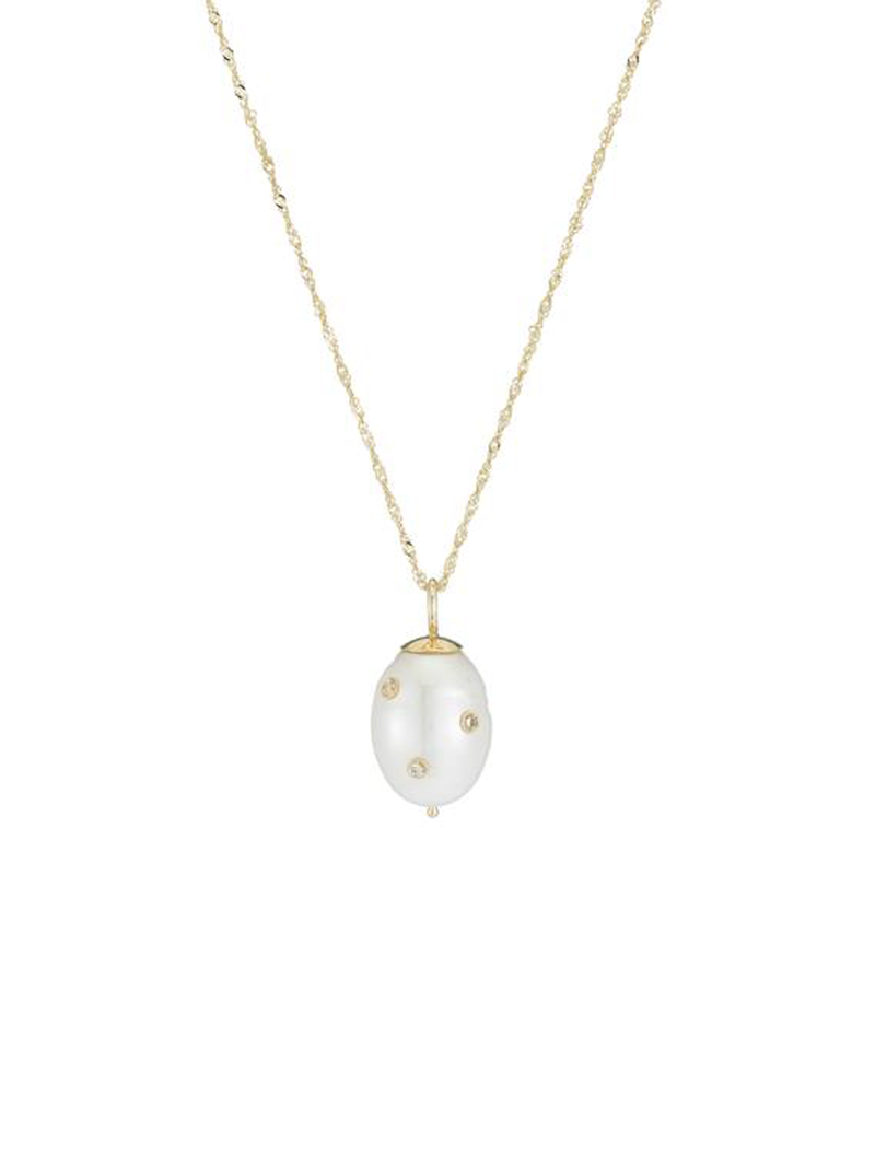 The ARIEL GORDON Baroque Pearl drop necklace with Diamonds features embedded diamonds riveted to the pearl on a lengthy, bright Singapore chain