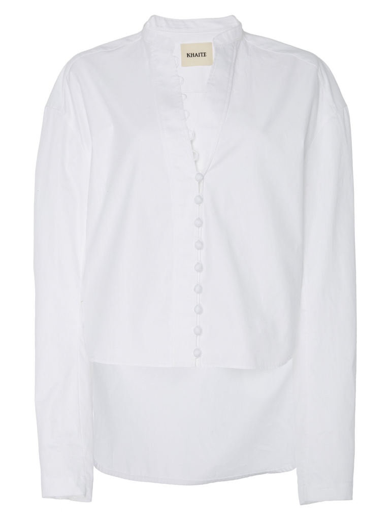 Khaite's 'Charlotte' top is designed with keyhole button fastenings through the front and long sleeves.