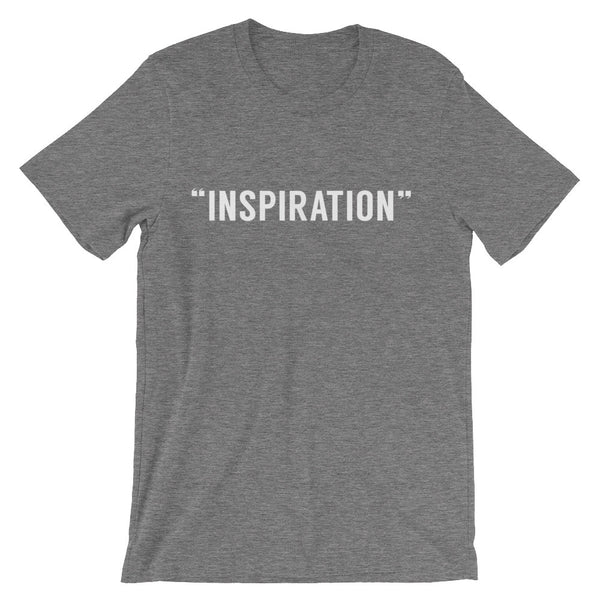 "grey round neck t-shirt with capital letters that read ""inspiration"" in white"